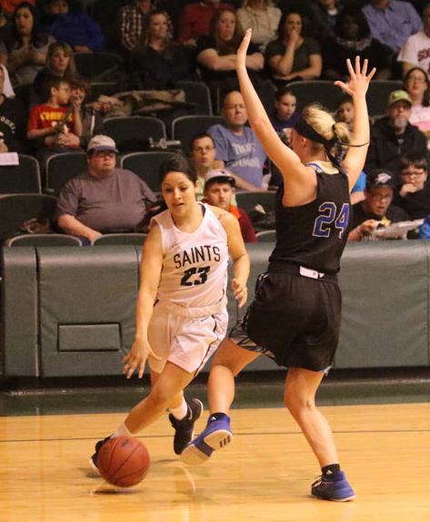Sophomore Vanessa Caro dribbles around a defender to shoot a reverse lay-up. Vanessa finished the game with a total of 13 points, three rebounds, two assists and a steal.