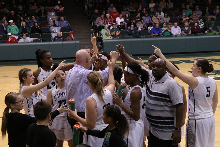 SCCC Womens Basketball Head Coach Toby Wynn leads the huddle before returning to the game.