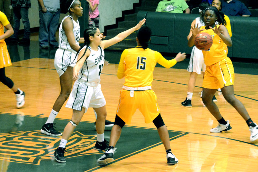 Vanessa Caro defends Lady Broncbuster, Kelcy McHenry. The Seward County Lady Saints remain undefeated at home (9-0).