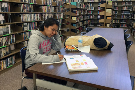 Sophomore, Neri Martinez, spends time in the library working on her homework when she doesn't have classes.