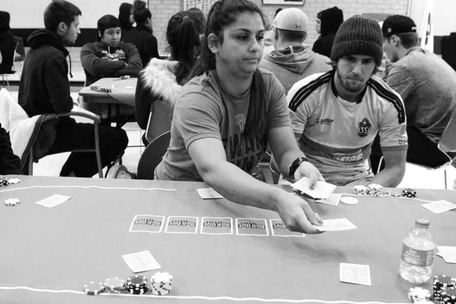 Thais Allen, volleyball coach, served as dealer at one of the six tables. She kept the game moving and helped students understand the game in the beginning. Once everyone learned how to play, she kept her table laughing by egging on the betting and competition.