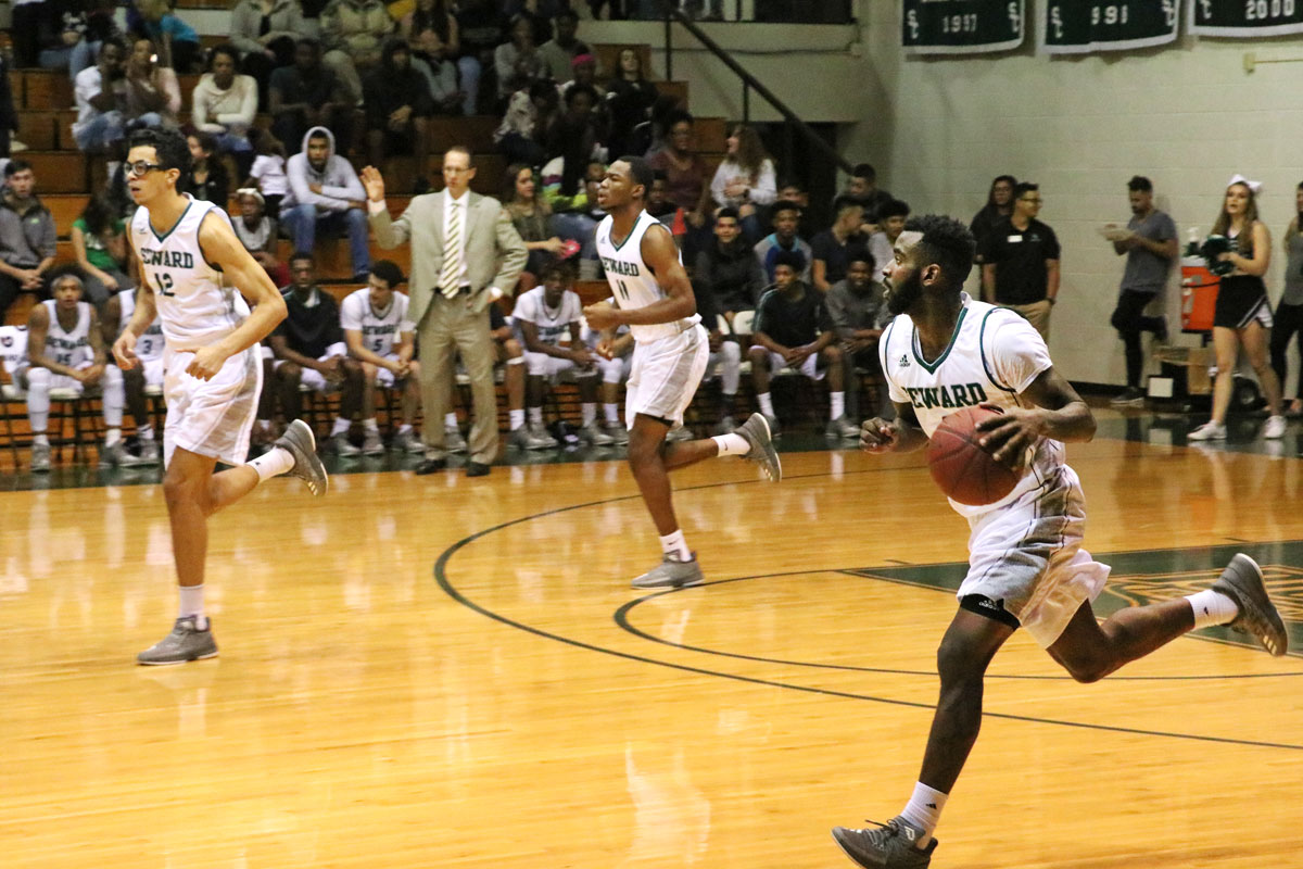 Freshman guard, dribbles down the court during a home game.