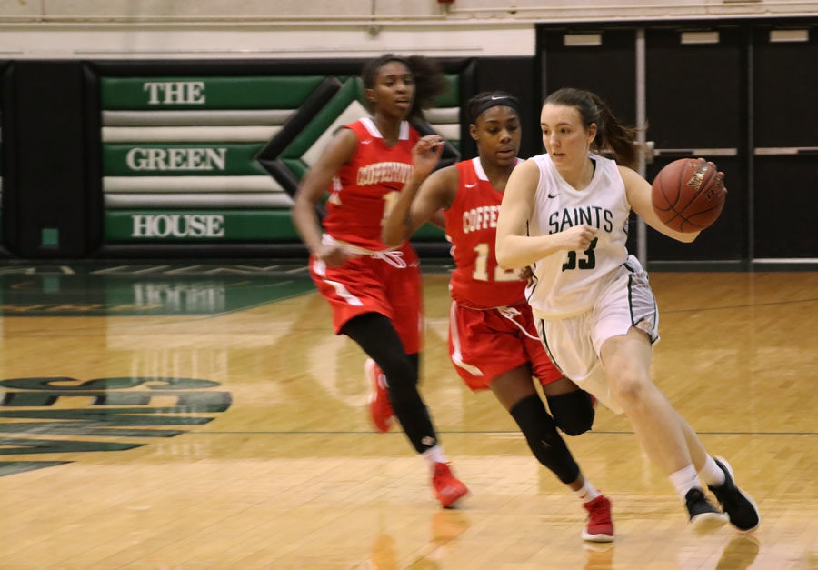 Freshman%2C+Chelsea+Lazenby+dribbles+past+her+opponents+after+getting+a+steal+during+the+second+half.+Lazenby+had+seven+points%2C+three+assists+and+a+steal.
