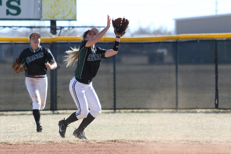 Sophomore infielder, Kaitlin Ammerman, attempts a catch during Sunday's double-header. The Lady Saints softball split with Lamar Community College, 10-1 and 5-1.