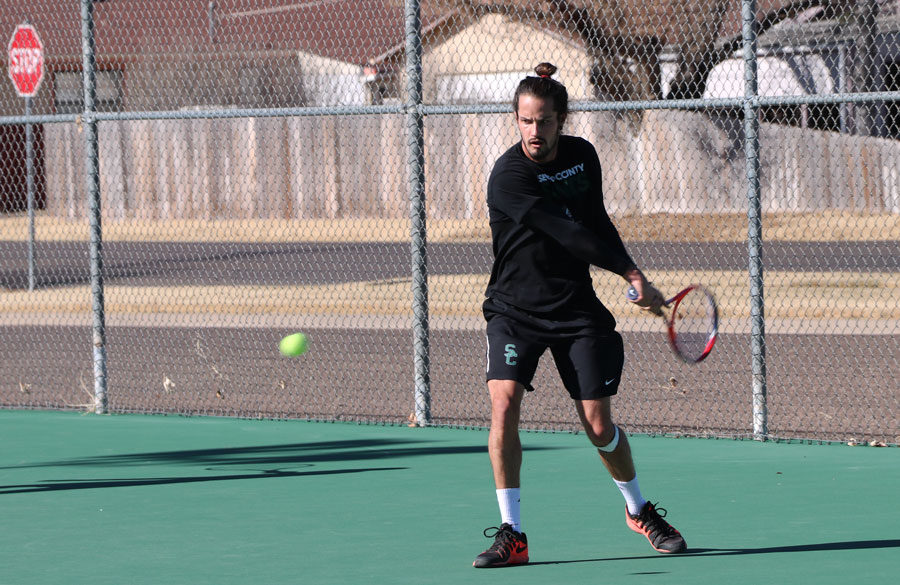 Freshman, Tim Lamare, practices his backhand swings during his afternoon practice. Lamare finished first in No. 4 singles spot.