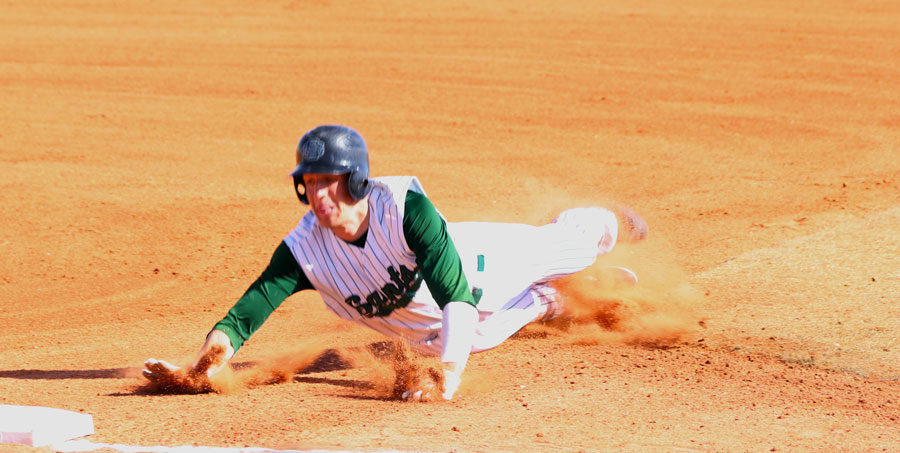 Dylan Paul attempts to slide to stay safe in the first game of the four-game series versus Northeastern.