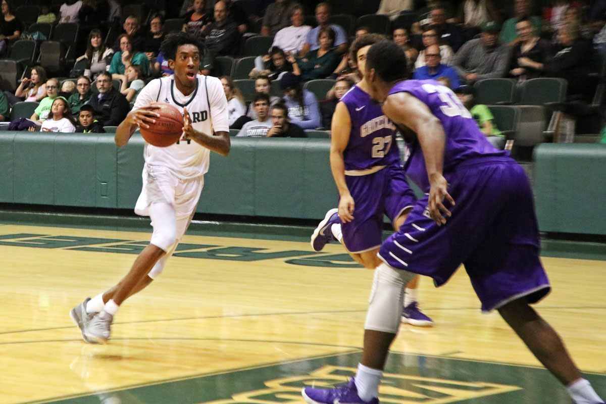 Isiah Small , freshman forward, drives the basket on a fast break in a home game earlier in the season. The Saints secured a home game in post season playoffs with a win over Dodge City Community College Feb. 24. (File Photo)