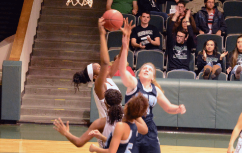 Covane battles for a rebound with a Colby opponent. SCCC broke four records during Wednesday nights game.