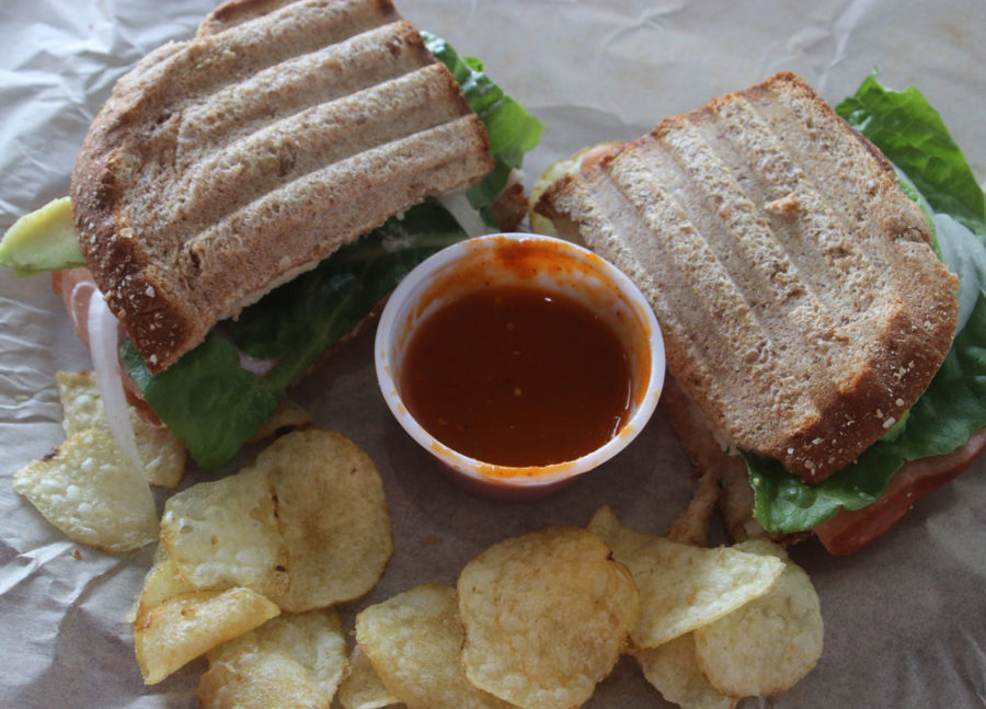 The Mana Club is made of whole wheat bread, mayonnaise, avocado, deli ham slices, muenster cheese, lettuce, tomato, and onion.  This savory sandwich delight is the signature sandwich of Dulce Mana.