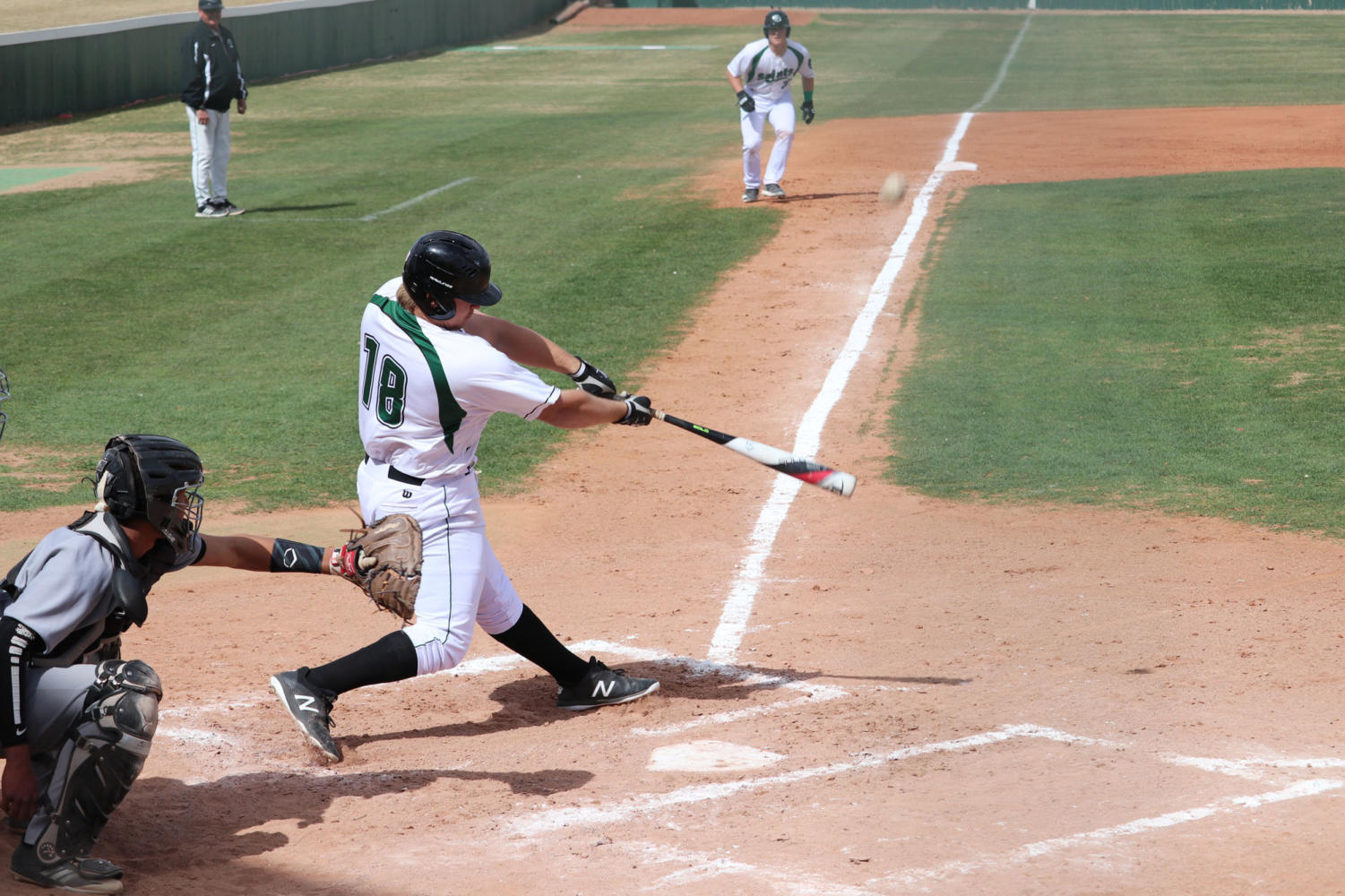Sophomore, Montana Newell hits a ball towards the left side of the field.
