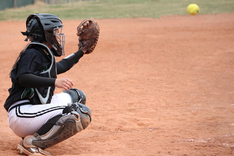 Sophomore+catcher%2C+Sage+Harrison%2C+prepares+to+catch+a+pitch+from+sophomore+pitcher%2C+Monique+Ashley.+