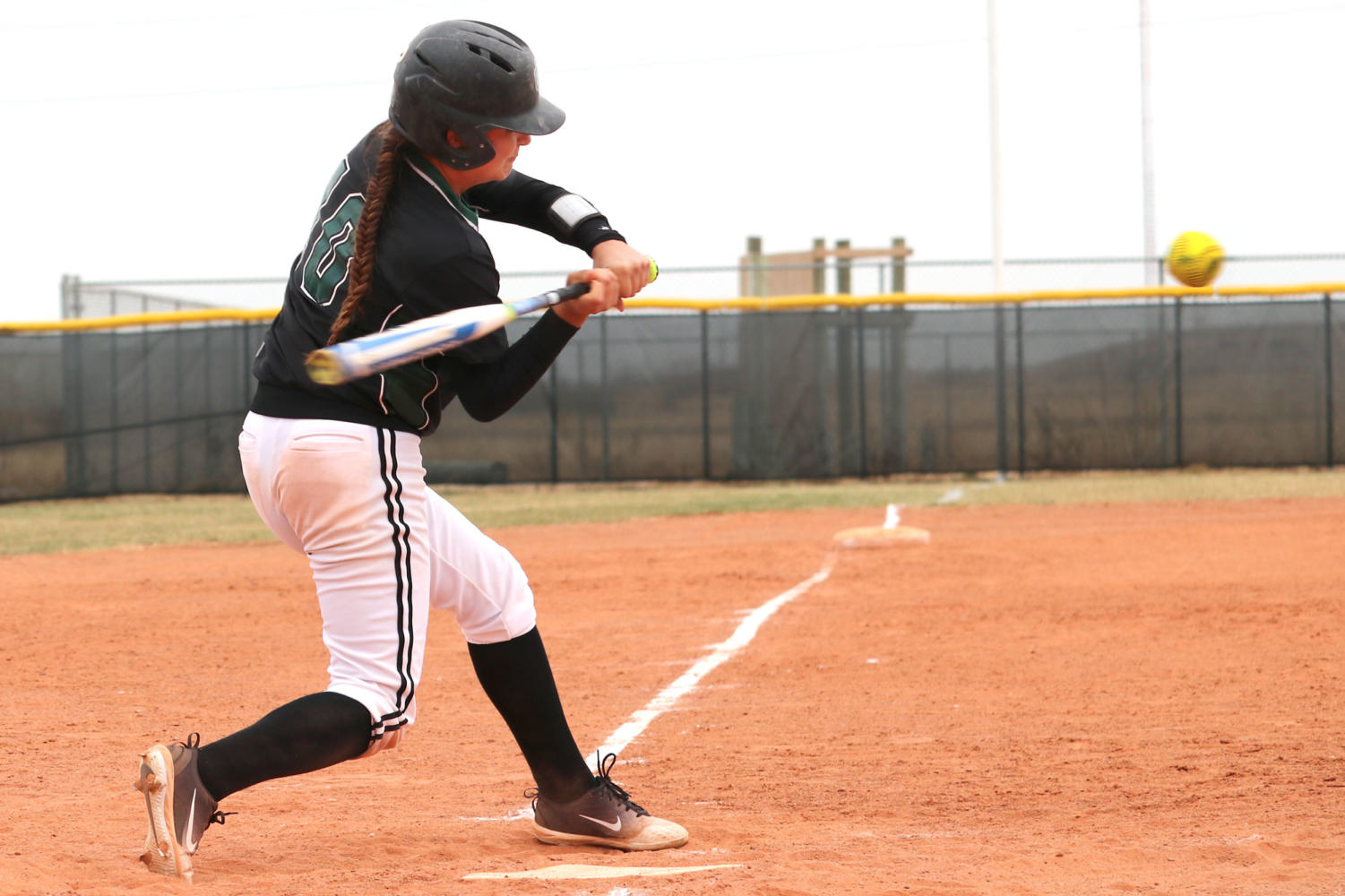 Freshman, Miranda Nester, swings at a pitch. (File Photo)