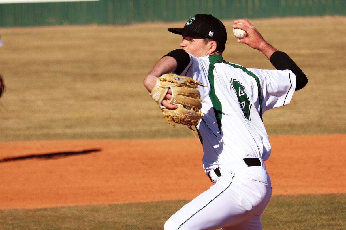 Freshman right-handed pitcher, Tanner King, pitches to an opponent. File Photo)