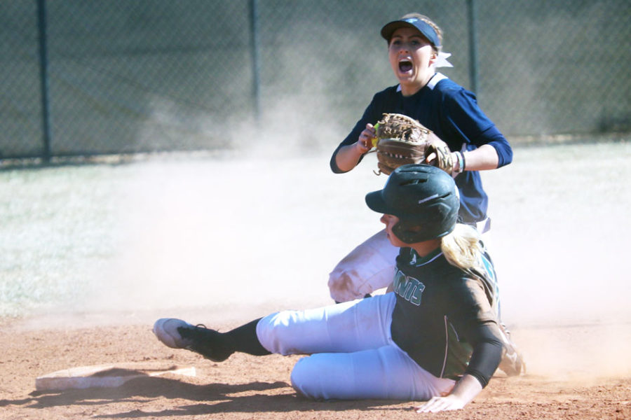 Sophomore Sydney Epp slides into second base but is tagged out by a Colby player. The Lady Saints beat Colby in both games of the double header. Part of the win came from aggressive base running backed up by solid hits.