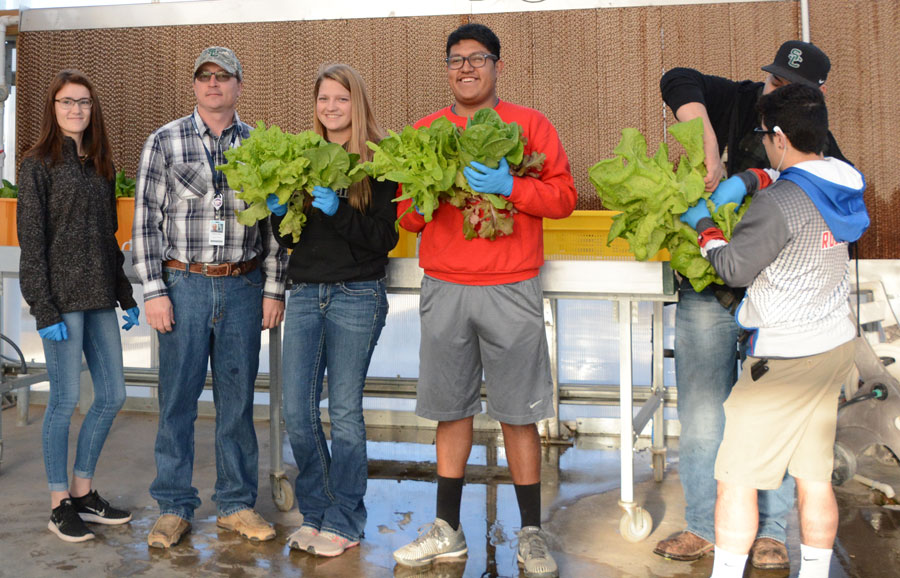 Concurrent student, Haley Yancey, instructor, Joshua C. Morris, and concurrent students,  Brooklynn Bauer, Adan Vera, Jalen Rosales, Felipe Darbyshire, and technician, Mereya Hughbanks help with the growing of all of the crops in the SCCC greenhouse.