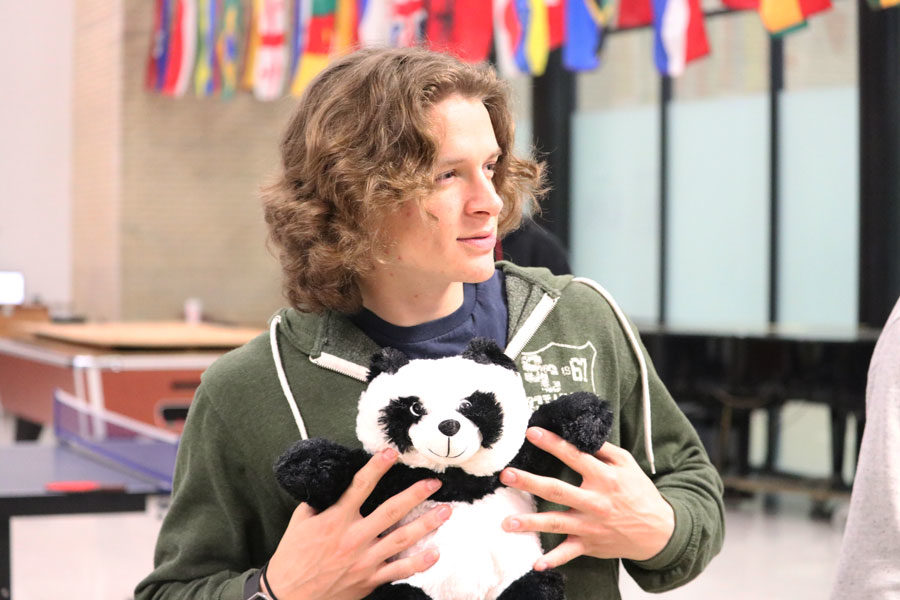"""Obadiah Barnett, freshman, poses with his panda stuffed animal. """"The reason why I chose the panda as my stuffed animal is because the first thing that came to my mind was the song called Panda and I had to pick it. Also, panda's are one of my favorite animals,"""" Barnett, said."""