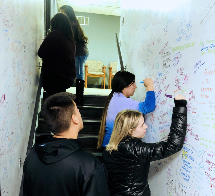 After escaping the escape room, Crusader staff members were able to sign the walls for their accomplishment.