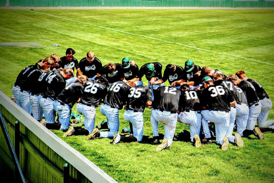 Seward County's baseball team prays over the team and the safety of their players before each game.