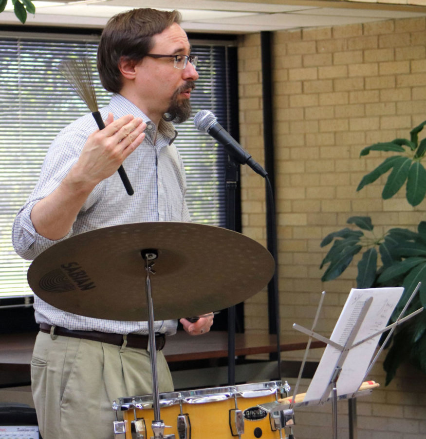 Kevin Rabas also read some poems with some drums.  Poems can also have music to go along with them to add more effect to the poem's meaning.