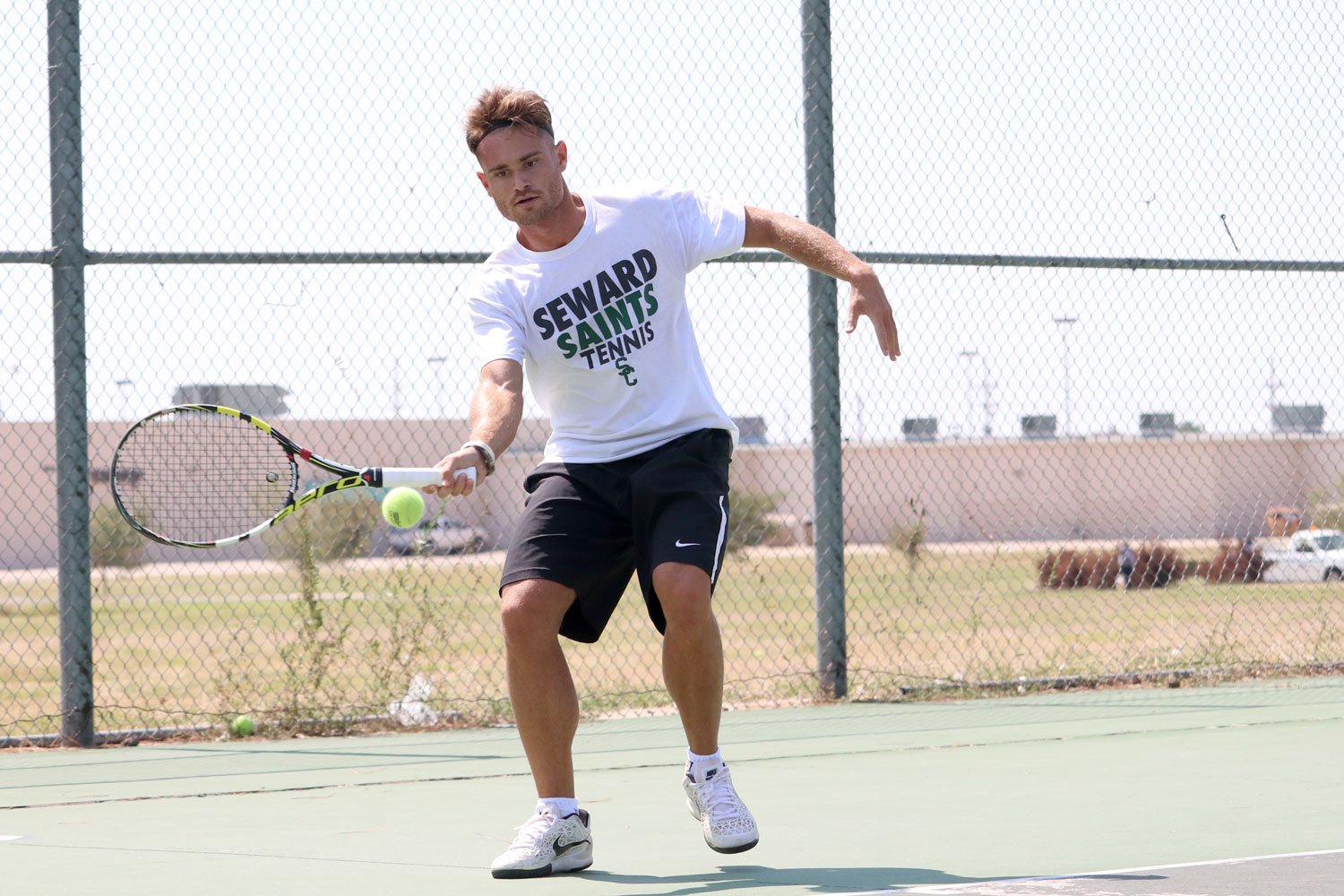 Sophomore Borja Font practices his serve. (File Photo)