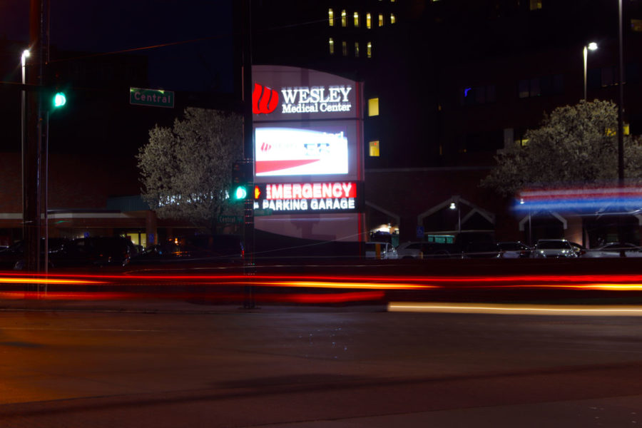 The hustle and bustle of traffic in the streets of Wichita on a cold Sunday night helps illuminate the city even more.  Street lights and restaurant signs help to light up Wichita's streets.
