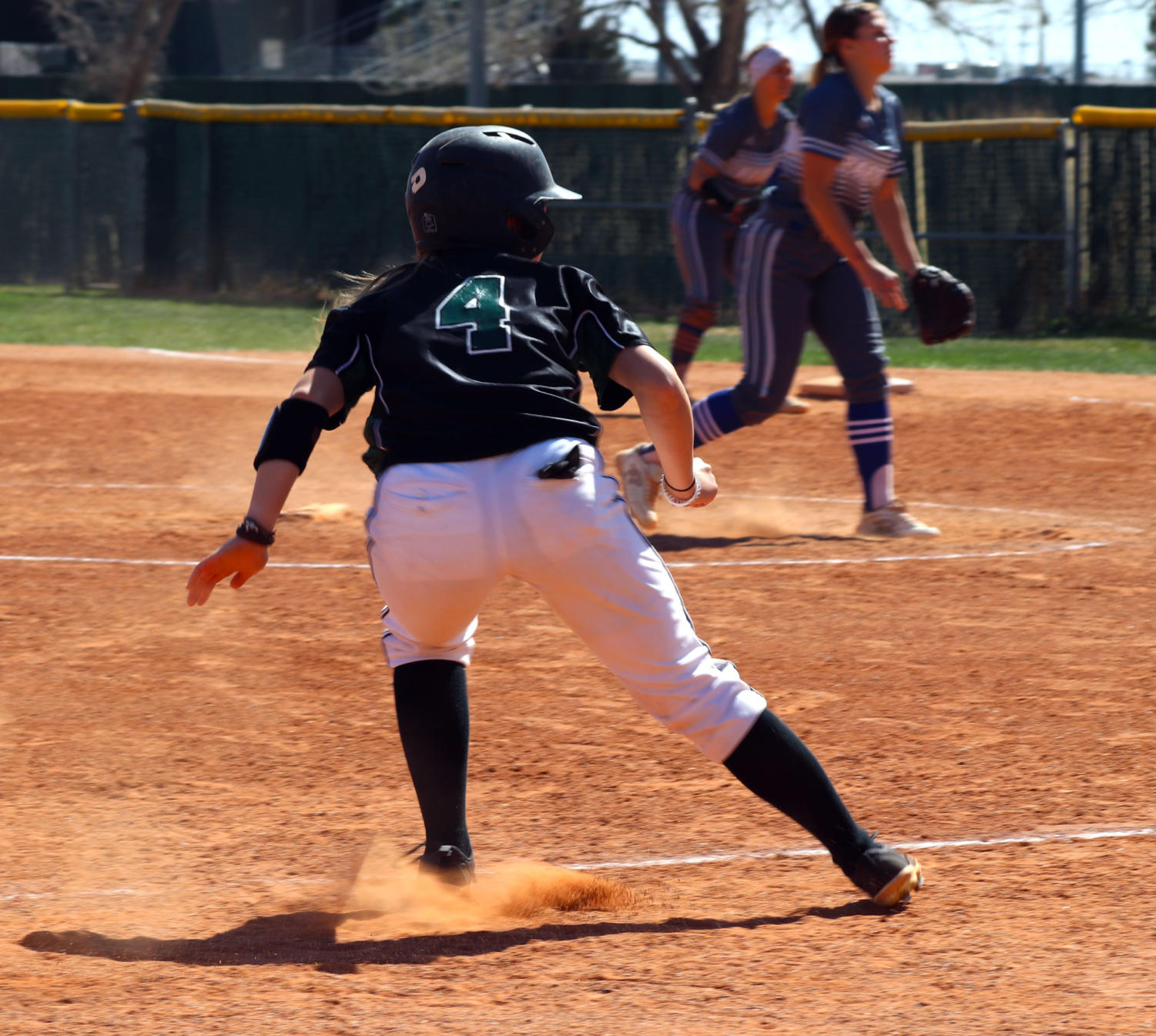 Paige+St.+Pierre%2C+sophomore+from+Maple+Ridge%2C+British+Columbia%2C+got+the+lead+off+third+base+to+see+where+the+ball+is+hit.++St.+Pierre+either+has+to+tag+up+to+third+base+or+steal+home+and+score.