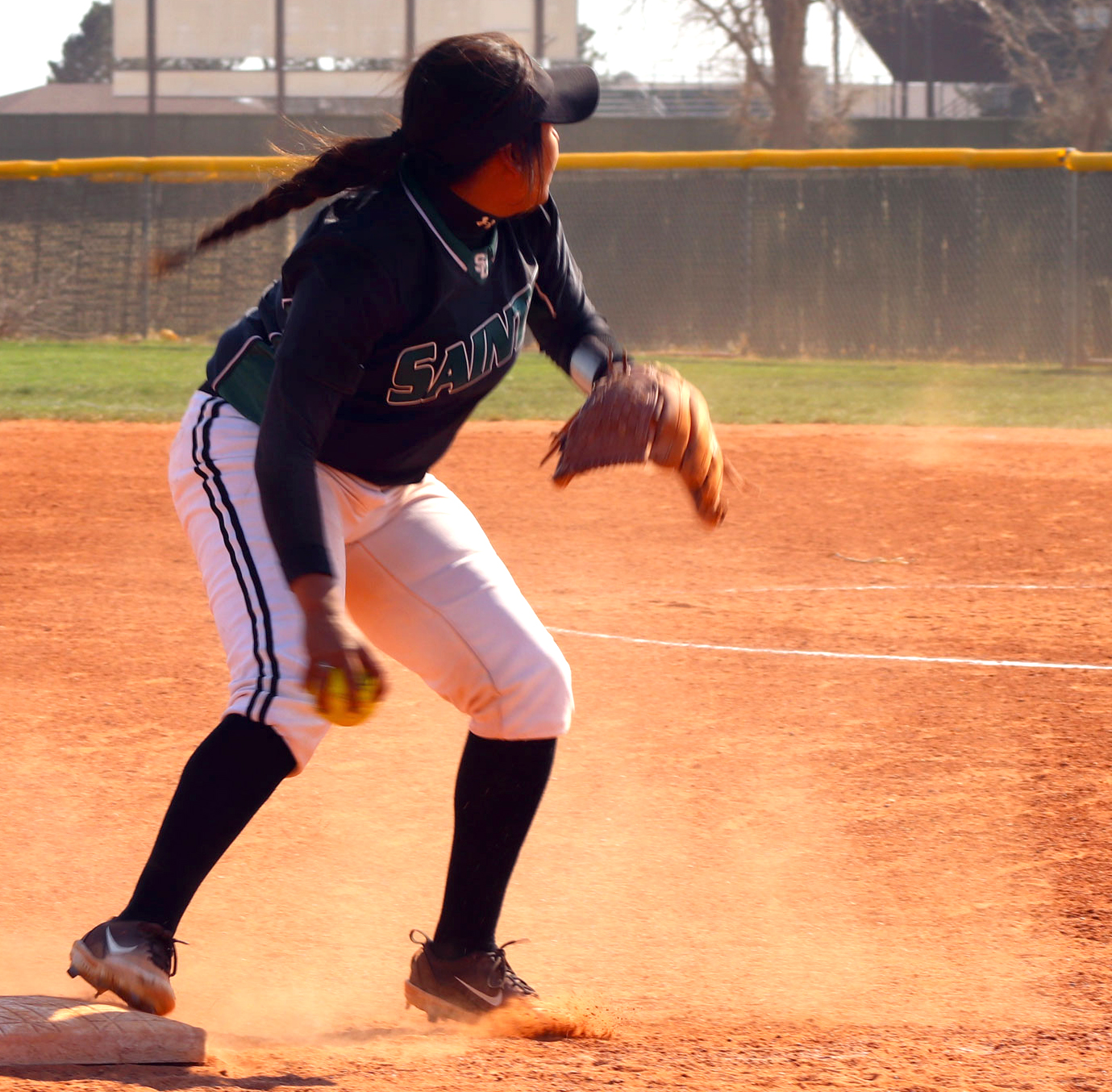 Corrina+Porras%2C+freshman+from+Colorado+Springs%2C+Colorado%2C+got+an+out+in+third+base.++Porras+threw+the+ball+to+first+base+where+they+got+another+out.