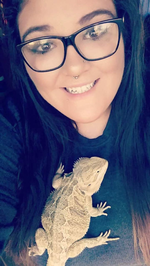 """The latest edition to Ruiz's """"babies"""" was her bearded dragon that she named Onyx.  The bearded dragon has a spoiled life filled with his own sleeping bag and water floaties."""