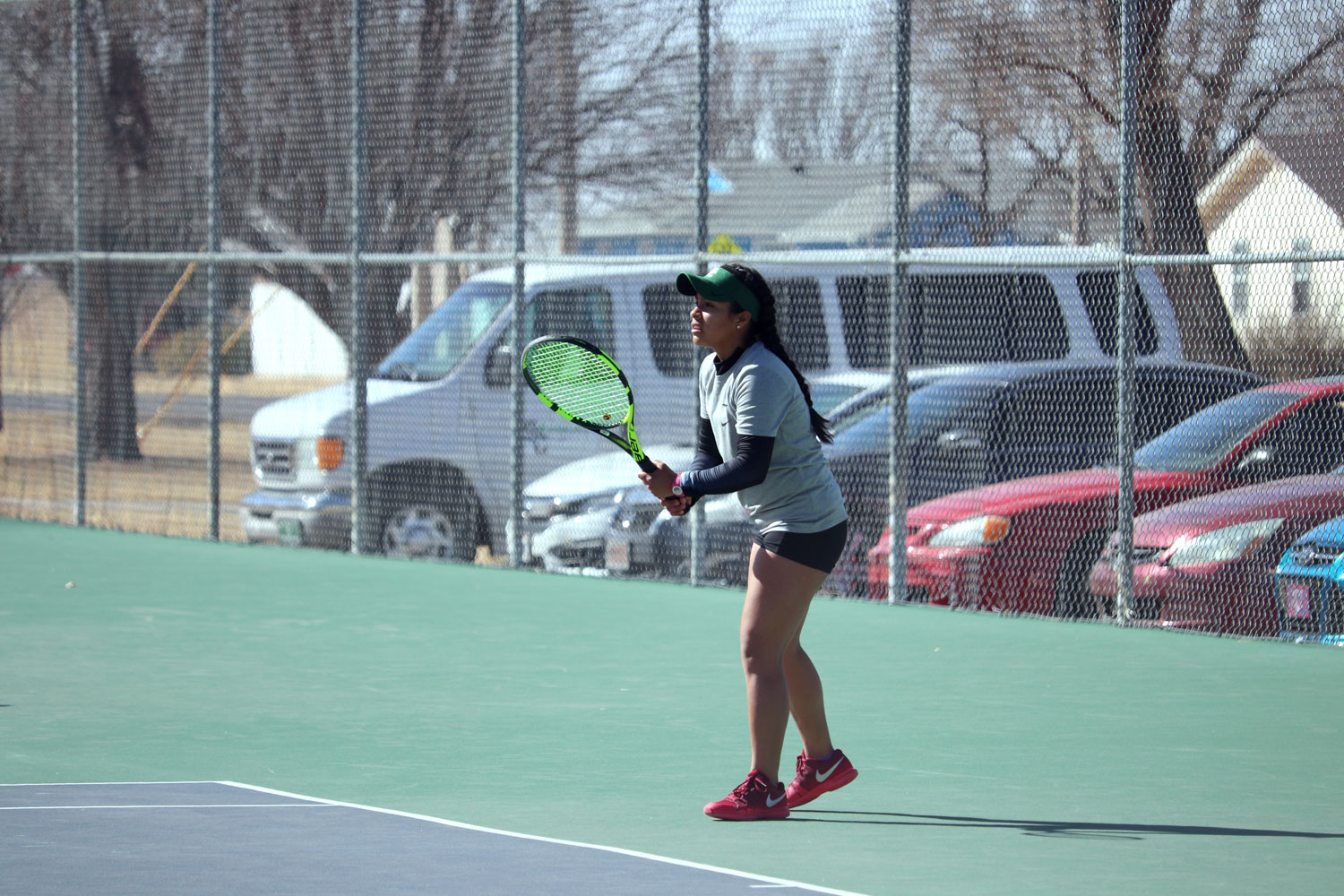 Freshman Patricia Panta prepares to receive a serve from an opponent. (File Photo)