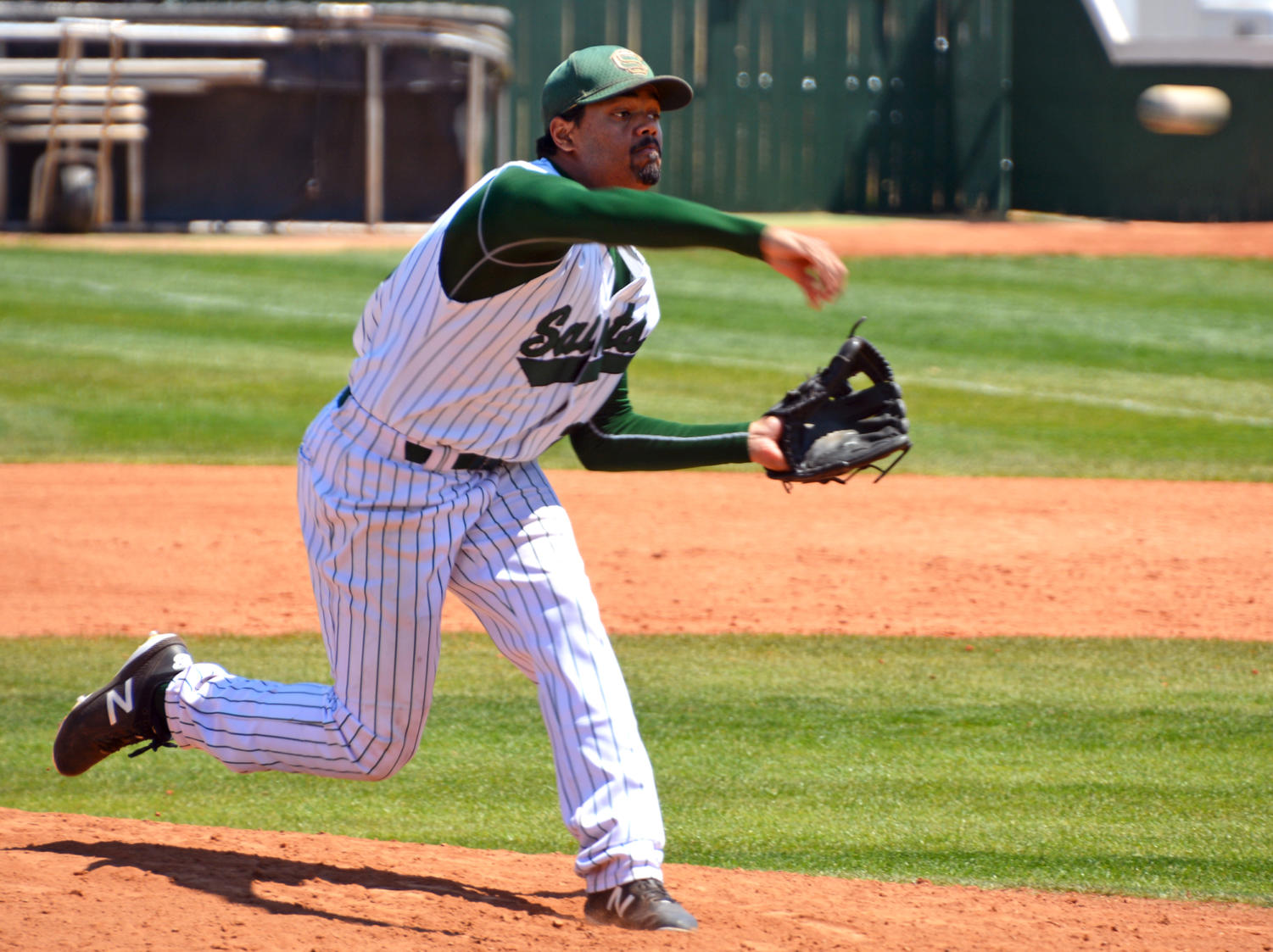 Jordan Pepper, sophomore pitcher, fires on in to the plate. The Saints played their way into the Region VI tournament by defeating Fort Scott in a best of three game series. (file photo)