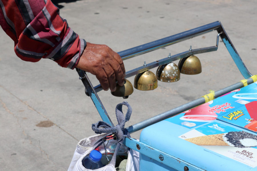 A paletero's hands are never far from the bells that call out to customers. Liberal has a long tradition with selling Mexican ice cream from a push cart, just like in Mexico.