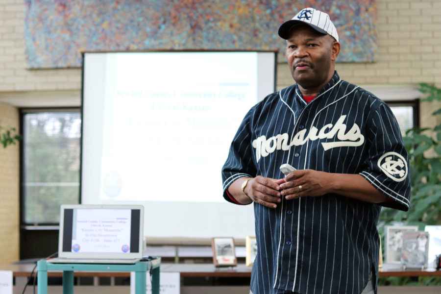 Dixon presents wearing his Kansas City Monarchs jersey and hat. The Kansas City Monarchs were the longest-running franchise in the history of baseball's Negro Leagues.