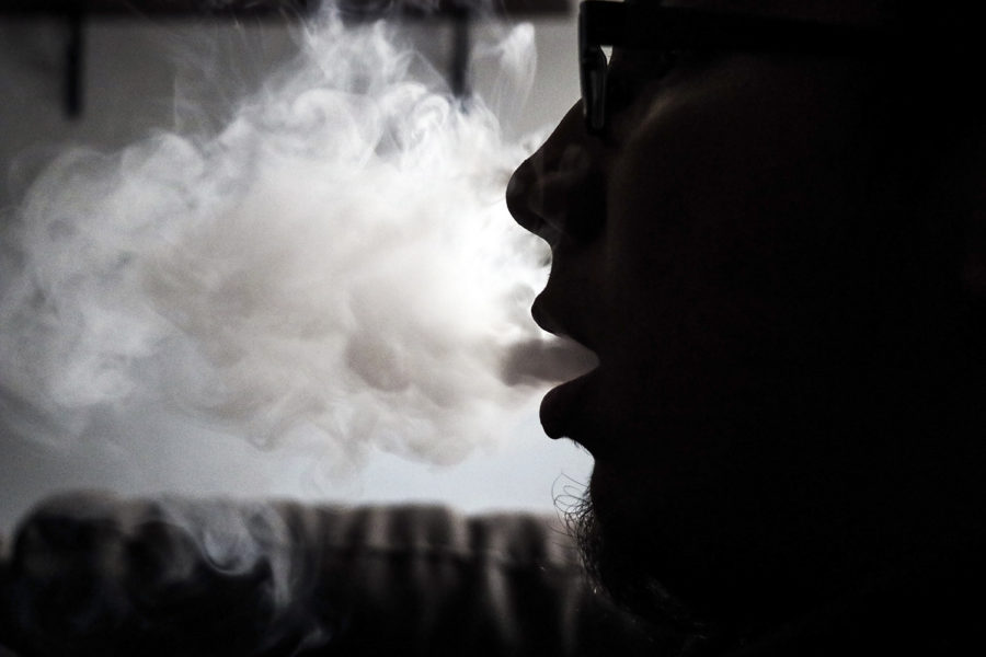 Irvin+Gaspar%2C+Freshman+HVAC+major%2C+blows+a+cloud+of+vape+smoke.+Gaspar+likes+vaping+because+it+helps+him+release+some+stress.+Blowing+smoke+in+rings+or+huge+puffs+is+a+popular+thing+to+do+when+chilling+with+other+vapers.