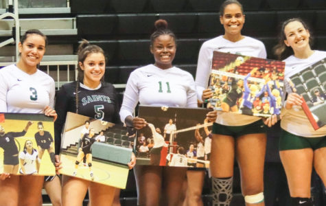 Setter, Esmadar Tavares; libero, Nathiellen Machado; middle/outside hitter, Aundrea Boyland; middle hitter, Luz Sierra and right side hitter, Giovanna Tapigliani pose for their picture on Sophomore Night. Sophomore Night honors players as they play their final season as Seward County Lady Saints.