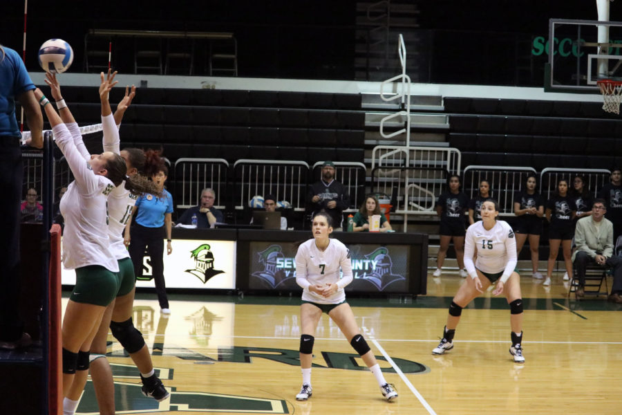 Freshman outside hitter, Djuly Schmorantz and Sophomore middle hitter, Luz Sierra block a Lady Cougar Hit. (File Photo)