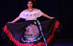 Former Cinco De Mayo Queen, Amy Zeledon performs on stage.