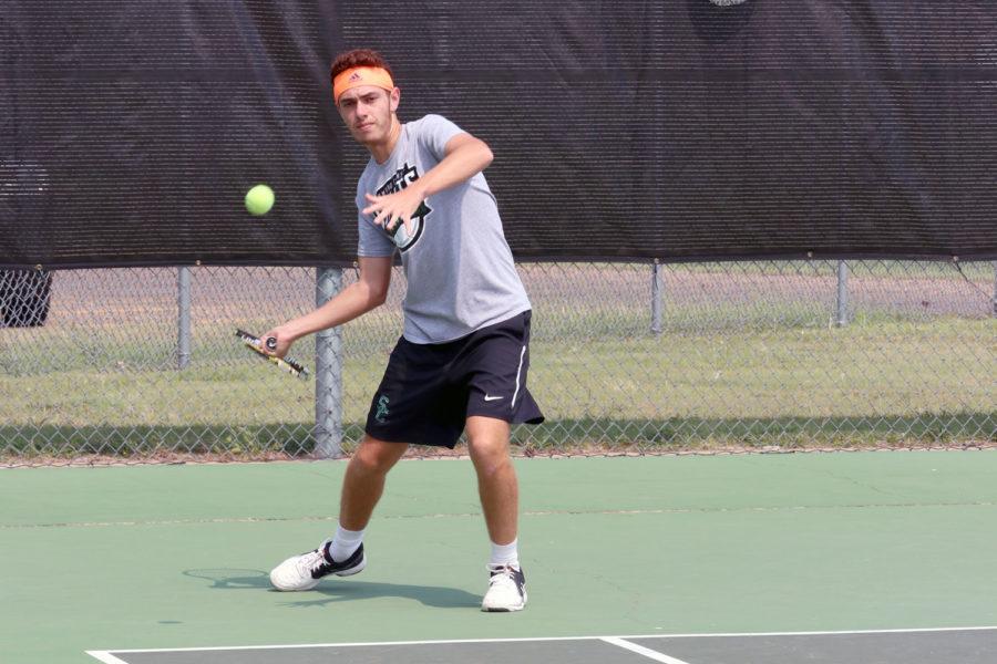 Sophomore Nicolas Rousset practices his return during pratice. (File Photo)