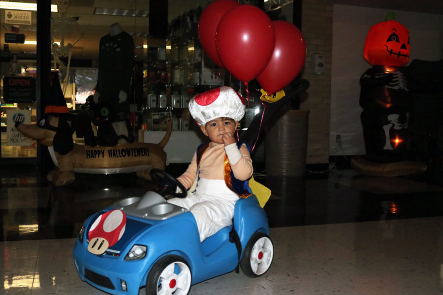Toad, also known as Andres Dominguez, poses for a quick shot in his race car. Toad is character from Super Mario Brothers.