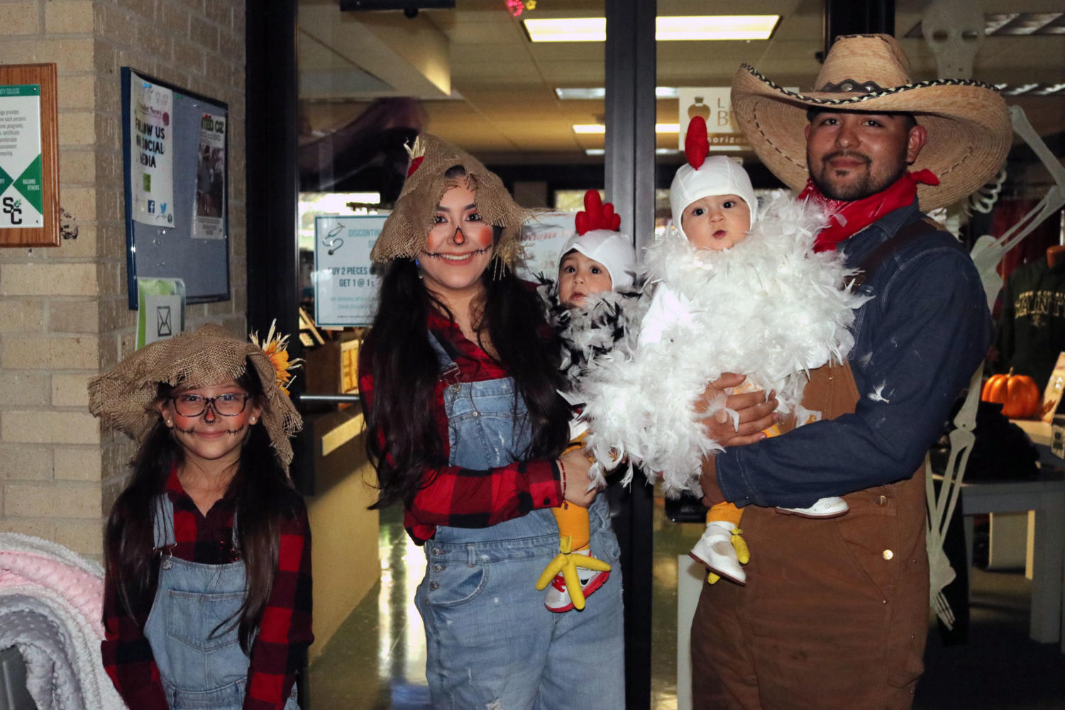 The Gomez Family poses in their farm-themed family costume. The Gomez children were dressed as scarecrows and chickens, along with their parents who dressed up  with them as well.