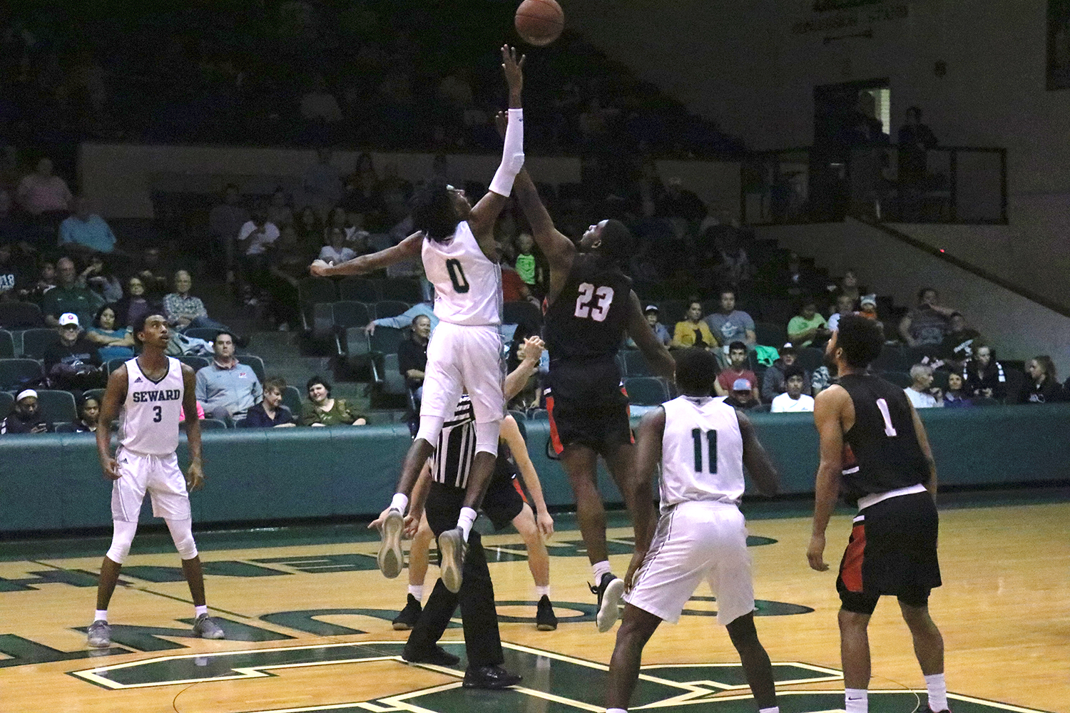 Sophomore guard, Isiah Small jumps for the ball during the tip-off of a game.