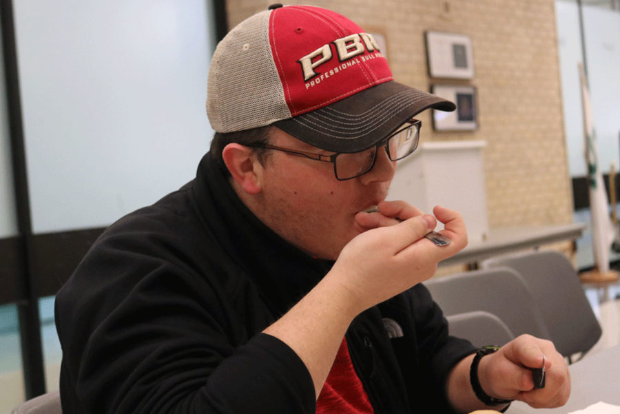 Cody Bradley, a business major from Liberal eats his Thanksgiving meal.