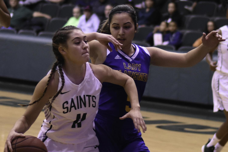 Sophomore guard, Lexi Hernandez dribbles past a Lady Plainsmen.