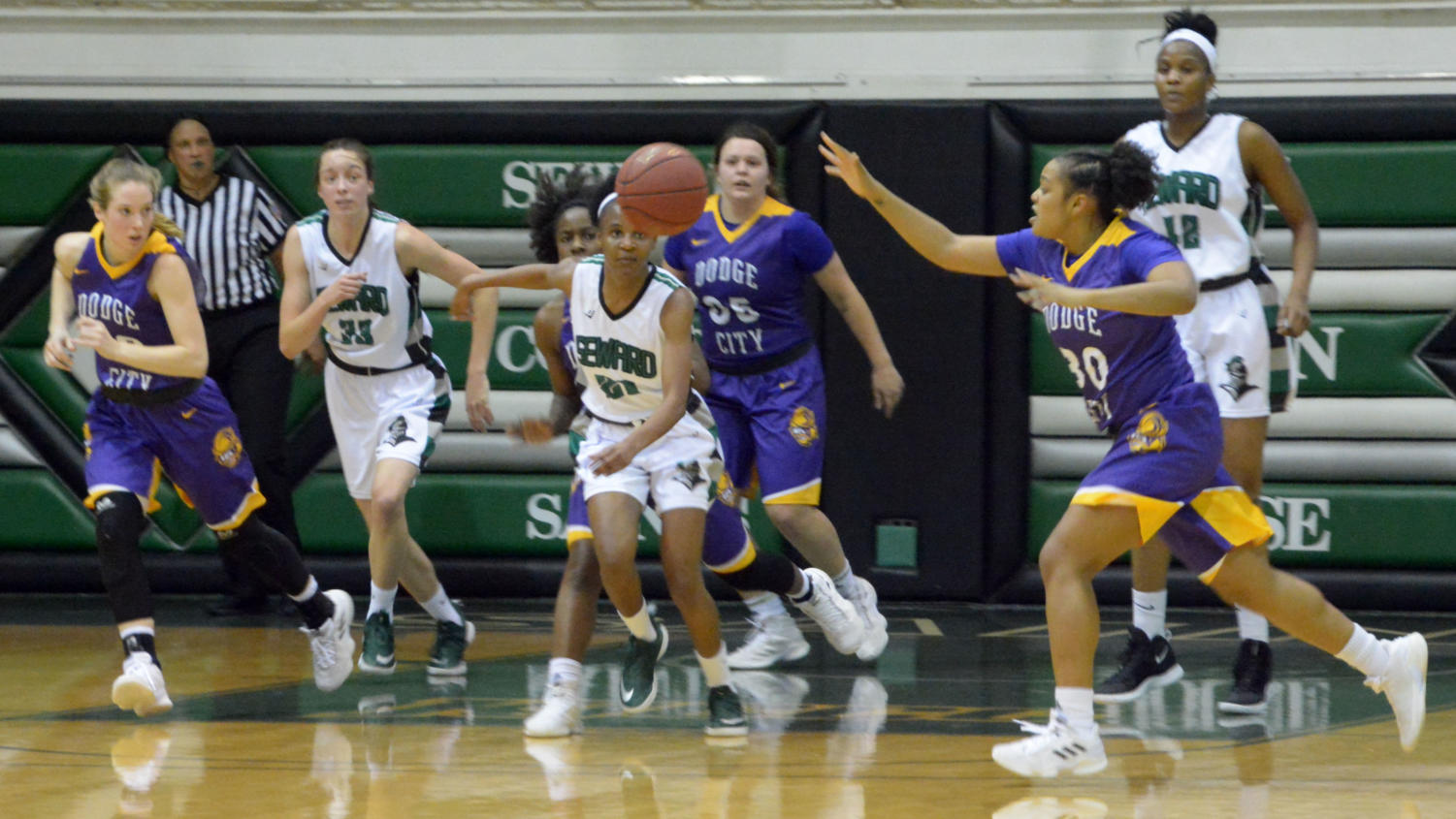 The Lady Saints fight for a loose ball against Dodge City on Jan 19. The Lady Saints played in the Greenhouse vs Dodge City. Seward won 63-51.