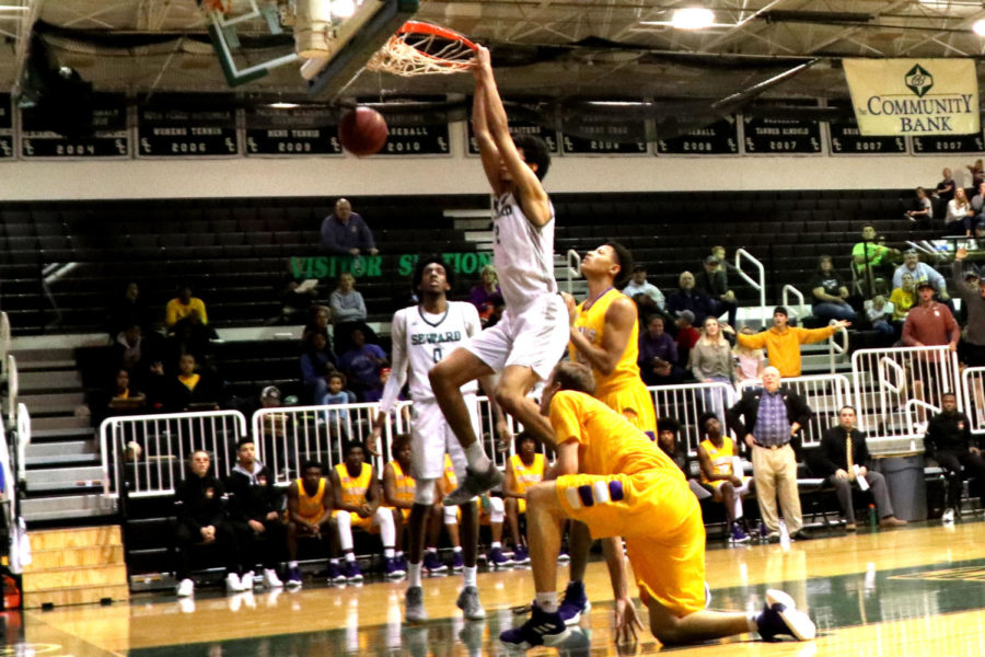 Mohamed Selmi with the power slam and hanging on afterward in the game against the Dodge City Conquistadors. In the Greenhouse on Saturday Jan 19.