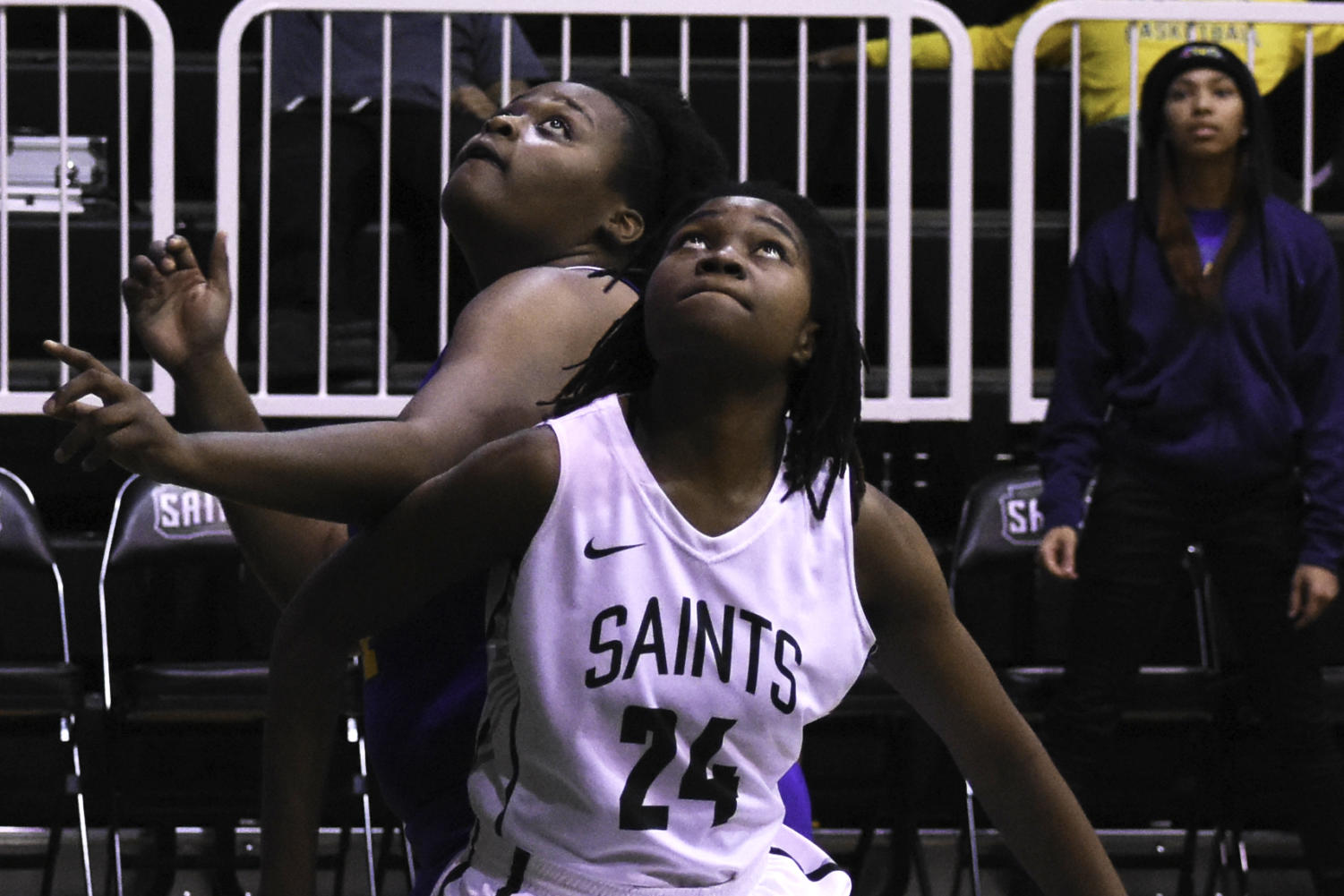 Vonda Cuamba, freshman forward from Maputo, Mozambique, boxes out for a rebound. The Lady Saints squeaked past Garden City Community College on Jan. 14 and brought their record to 14-2 overall on the season. (File Photo)