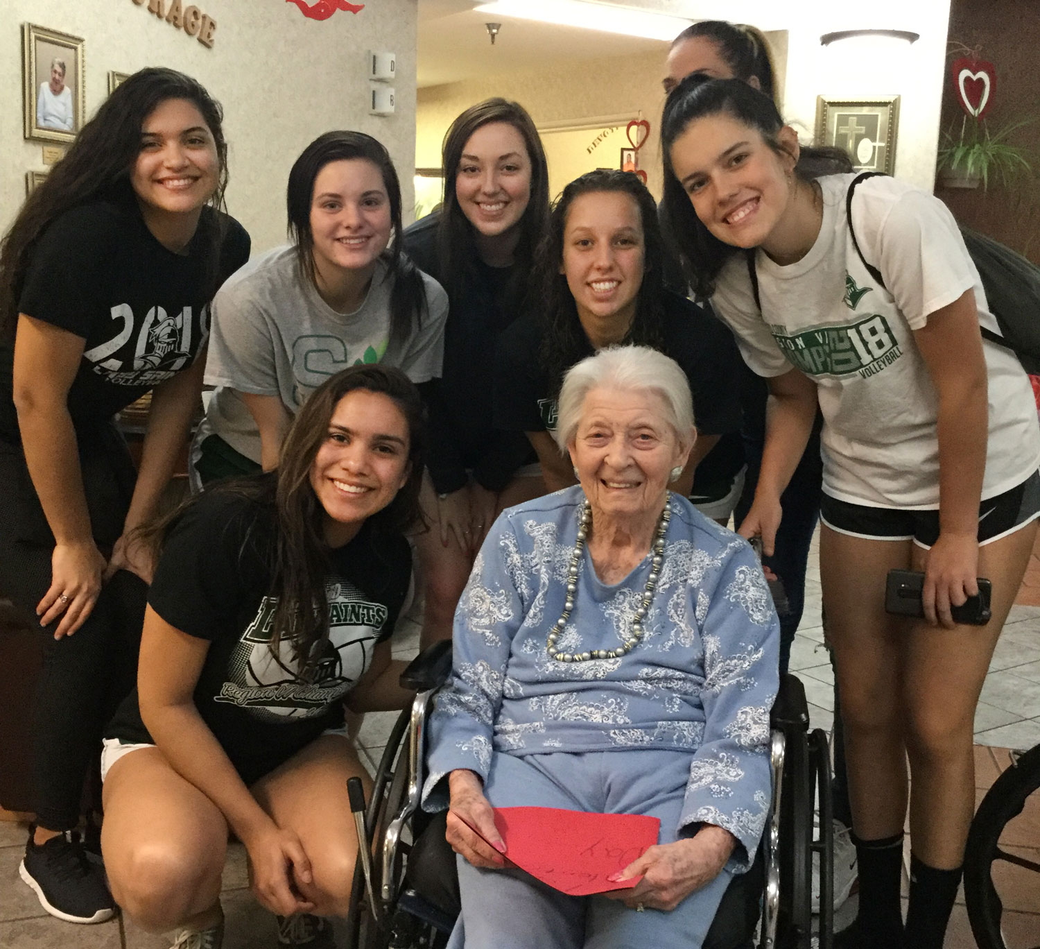 The+Lady+Saints+volleyball+team+spent+the+afternoon+visiting+area+nursing+home+residents+and+delivering+homemade+valentine%27s+cards.+Students+from+the+college+visited+three+homes+on+Feb.+14.