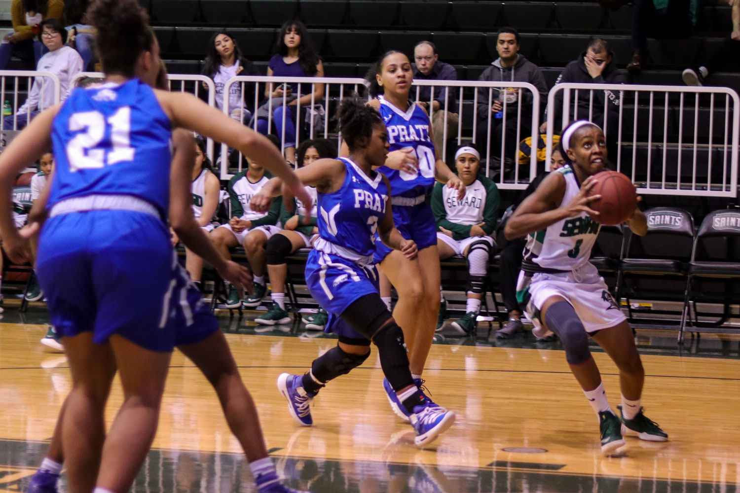 Freshman gaurd Aquila Mucubaquire goes up to make a shot against the Pratt Lady Beavers on Feb. 9 in the greenhouse.