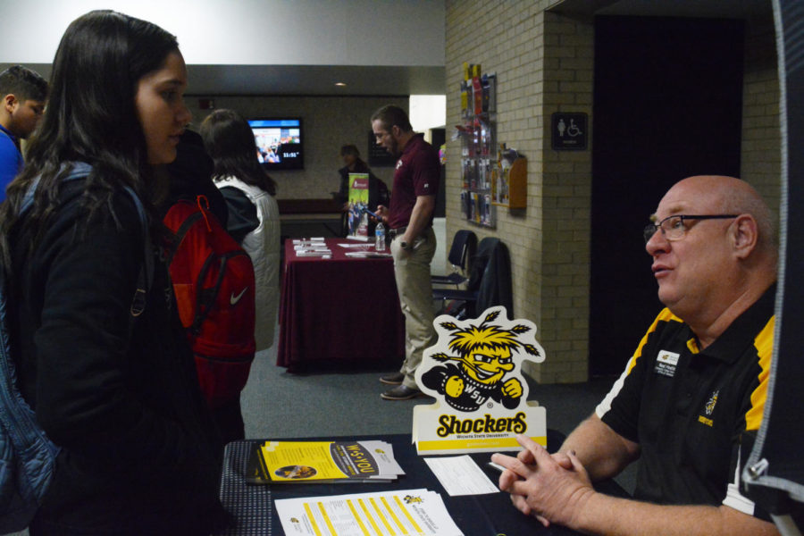 Ali Lucero talks to Neil Hoelting a representative from Wichita State. Students ask questions about financial aid and what the steps are to transfer.