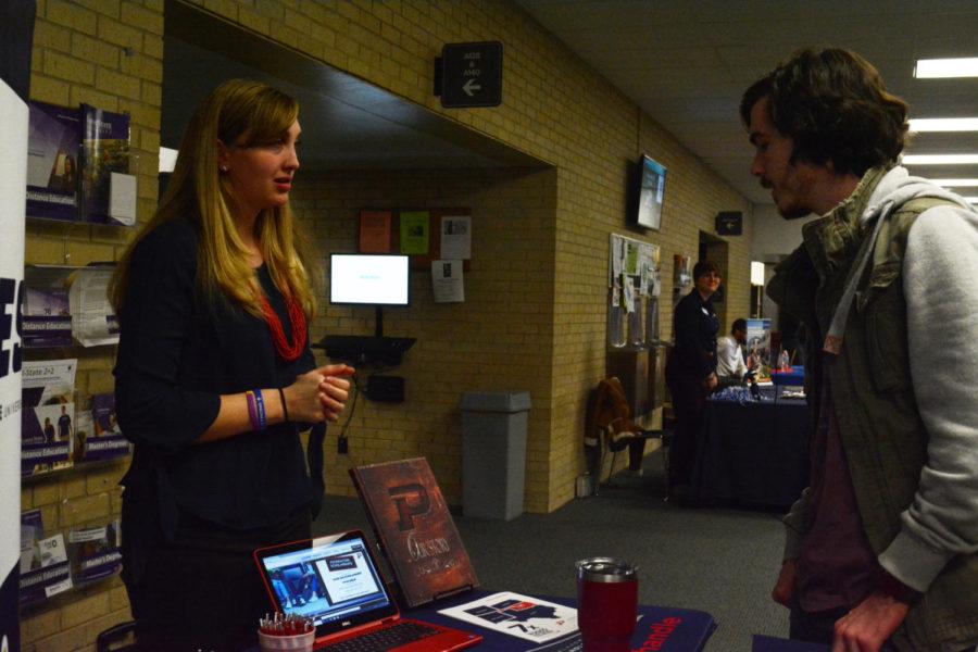 Chandler Harp talks to Oklahoma State Panhandle rep Hannah Hammock.