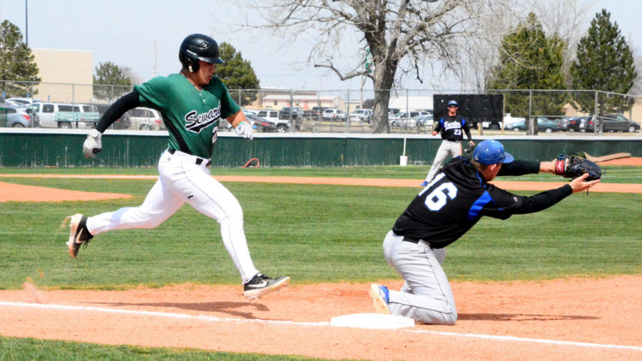 Jose Caraballo, sophomore shortstop from Puerto Rico, stretches out his stride to beat the throw to first base. He was called out by half a step. The Saints swept the doubleheader against Barton Community College on March 28.